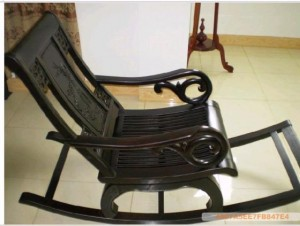 An antique black rocking chair in rosewood is sure to add beauty to your home decor