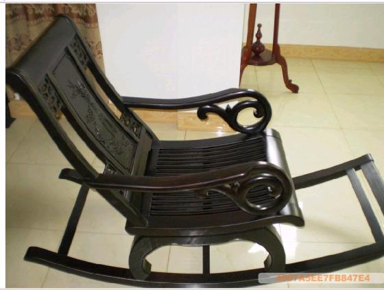 An antique black rocking chair in rosewood is sure to add beauty to your  home decor - Grandma's Rocking Chair Fashionably Desi